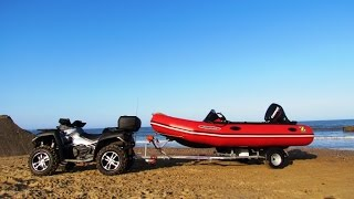 Quadzilla X8 800cc Quad bike towing boat on boat launch ramp on Fraisthorpe beach