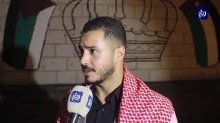 """متطوعون في الكرك يكتبون شعار """"أردن 73"""" بالشموع احتفالاً بعيد الاستقلال (26-5-2019)"""