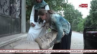 ريهام سعيد تفشل في حمل شيكارة أسمنت أسوة بـ«فتاة التروسيكل» (فيديو) | المصري اليوم