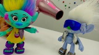 Kids' games. Trolls toys in the hair salon.