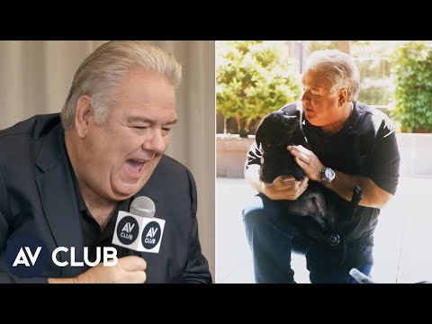Jim O'Heir watches Jim O'Heir play with puppies