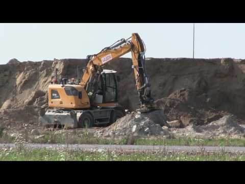 A 918 Compact Litronic Liebherr Wheeled Excavator Digging