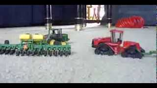 1/64 tractors with tracks planting corn