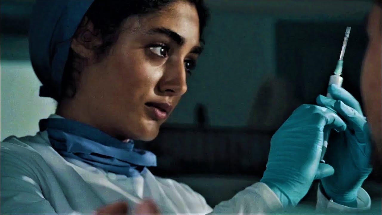 Golshifteh Farahani in blue latex gloves