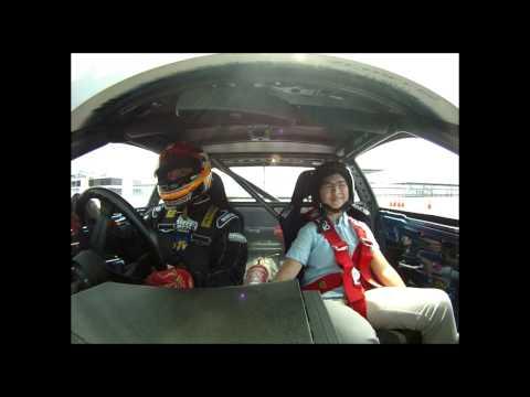 Drift driver Charlie Ng takes TNP reporter Kwan Hu...