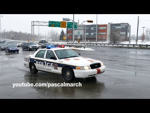 Cops block road for ambulance motorcade - Cortège coin Taschereau / St-Georges