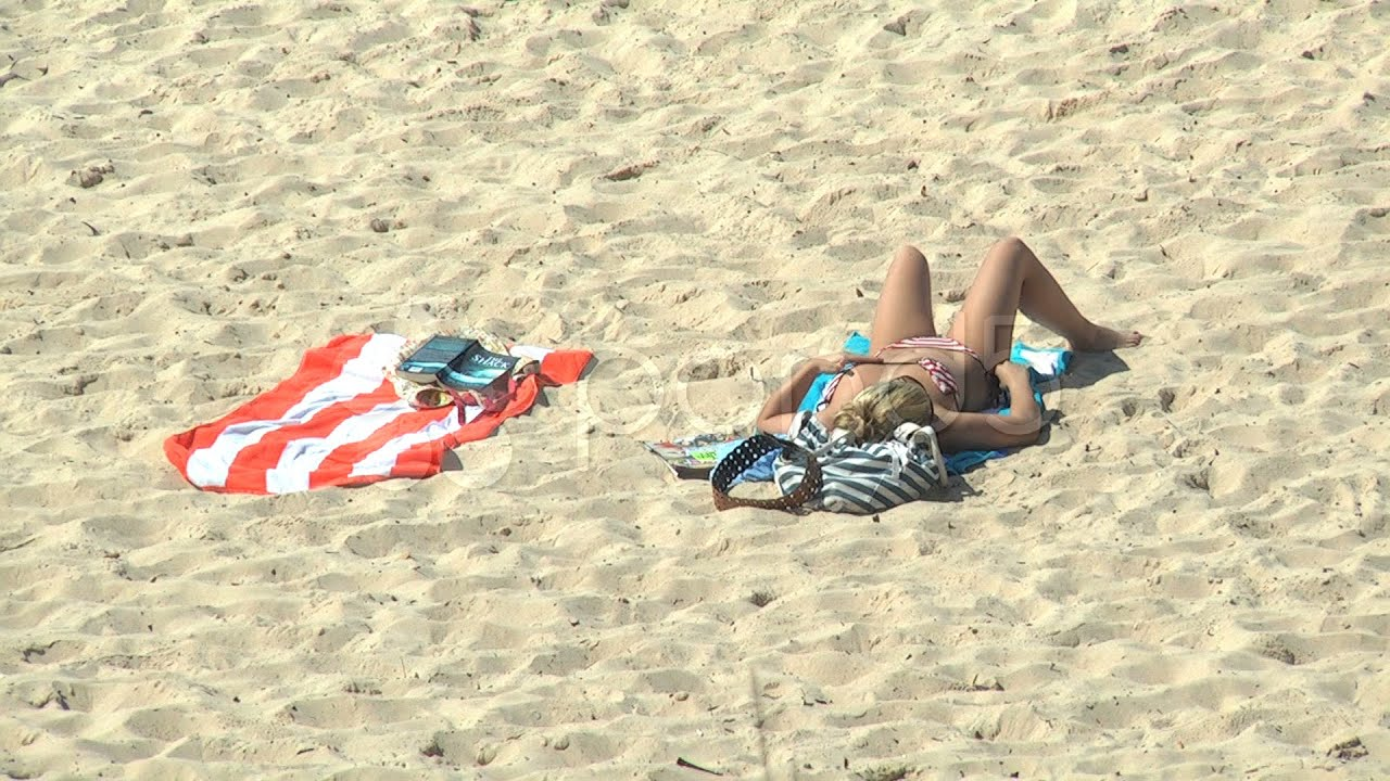 girl-sunbathing-on-beach-bikini-pictures-tied-open-cunt