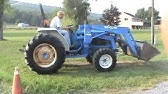 COMPACT TRACTOR New Holland T1520 - YouTube