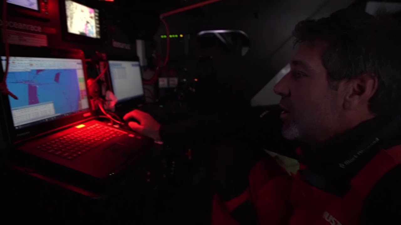 Charlie and SiFi look at the chart. SiFi: Right now if I was a betting man I'd say that Dongfeng is pretty good. They're 7 miles behind the leading boat, which is MAPFRE. And they're laying in doing 14 knots. Three other boats to weather.