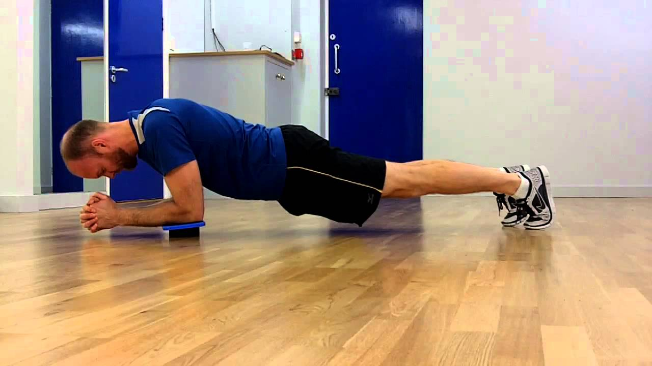 balance and wobble board workout punishing plank for core strength
