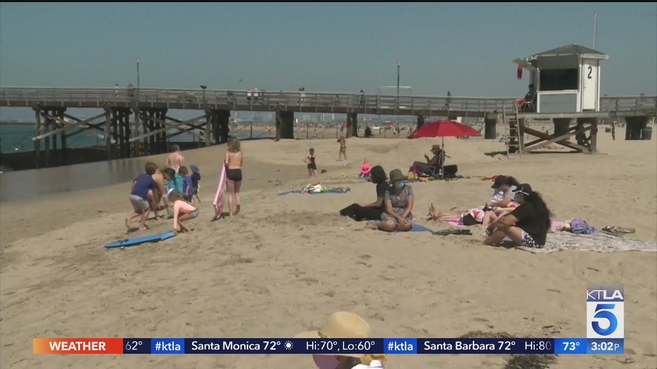 Californians mark July 4 weekend with closed bars, beaches