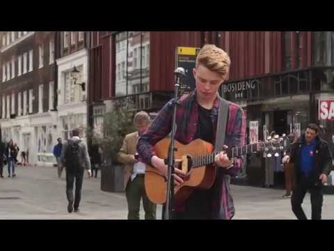 Tim Newman plays Ho hey by The Lumineers while busking on Oxford street in London
