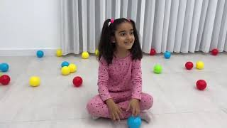 Kids are playing with colorful balls You2Audio Com