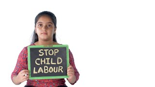Young fearful girl fighting for her freedom while holding a symbol against child labor