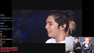 Heechul and Kyuhyun watching SJ's live perf of Believe