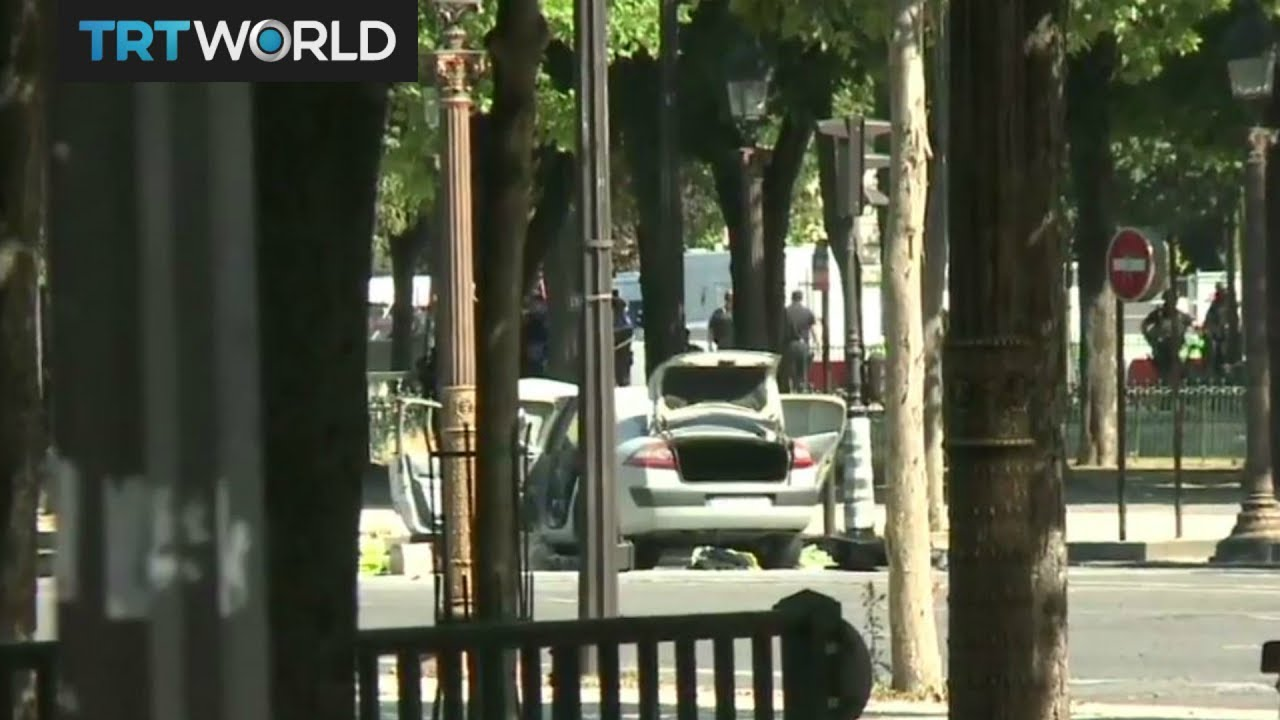 Driver dies after ramming car into police vehicle on Champs-Elysees in ...