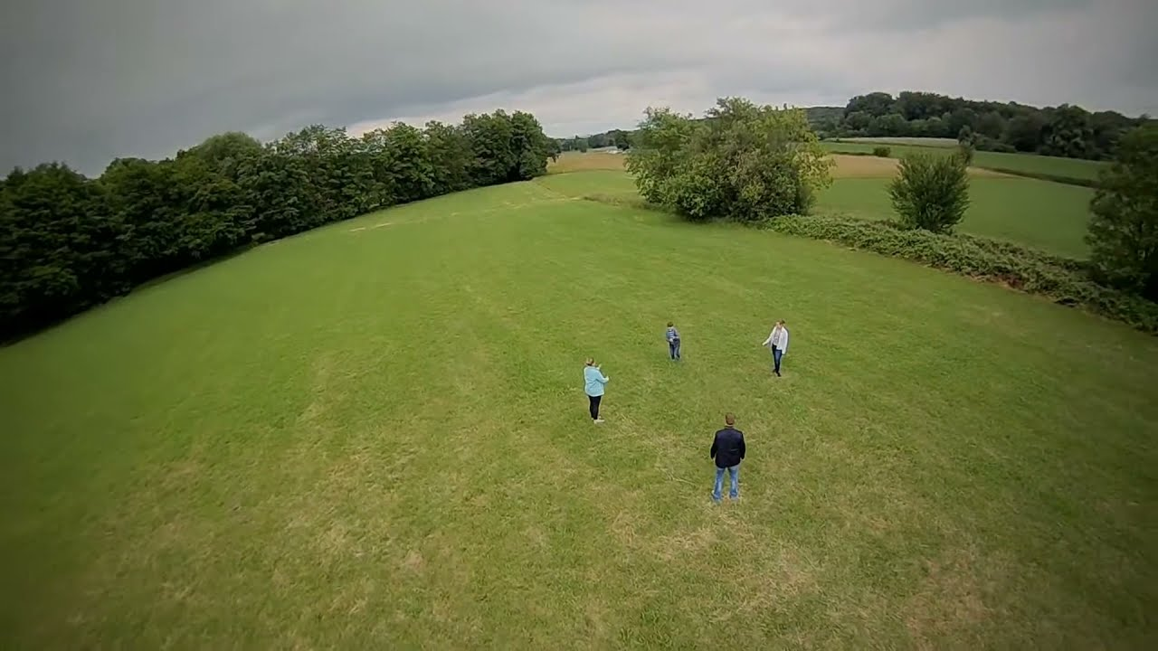 Family playing on the field #fpv #drone фото