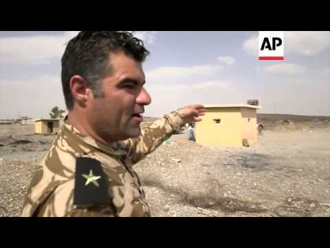 Kurdish military takes bridge and base held by IS group in northern Iraq