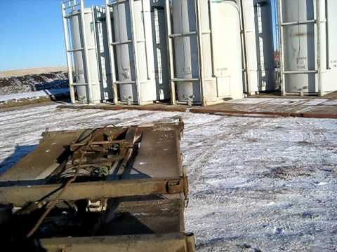 Texas Bed Raising A Tank Farm - Alberta Oilfield