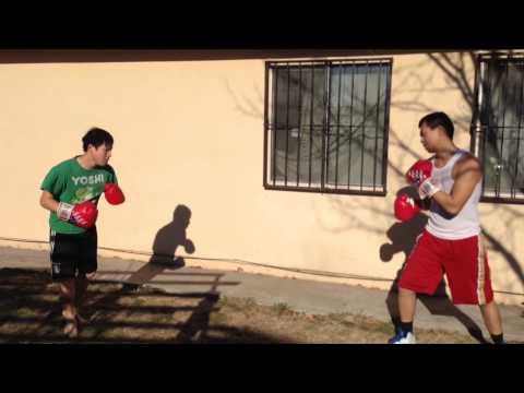 Hmong Boxing: Phillip (red trunks) vs Jerry (black trunks) 2014