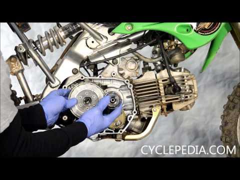 Cyclepedia.com Kawasaki KLX110 Clutch Cover Install External Shift Mechanism Alignment