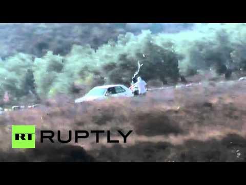 State of Palestine: Israeli settlers smash Palestinian's car after injuring British volunteer