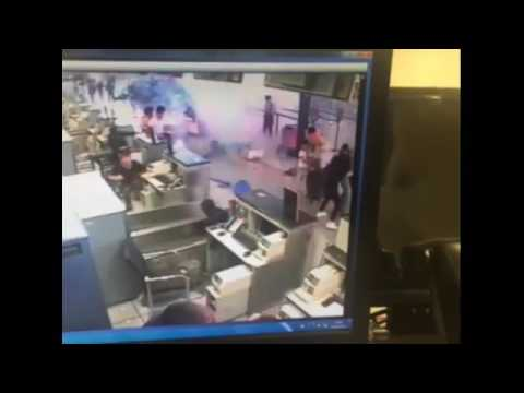 Startling moment luggage EXPLODES at Shanghai airport security