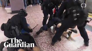 Hong Kong riot police use batons in clash at metro station