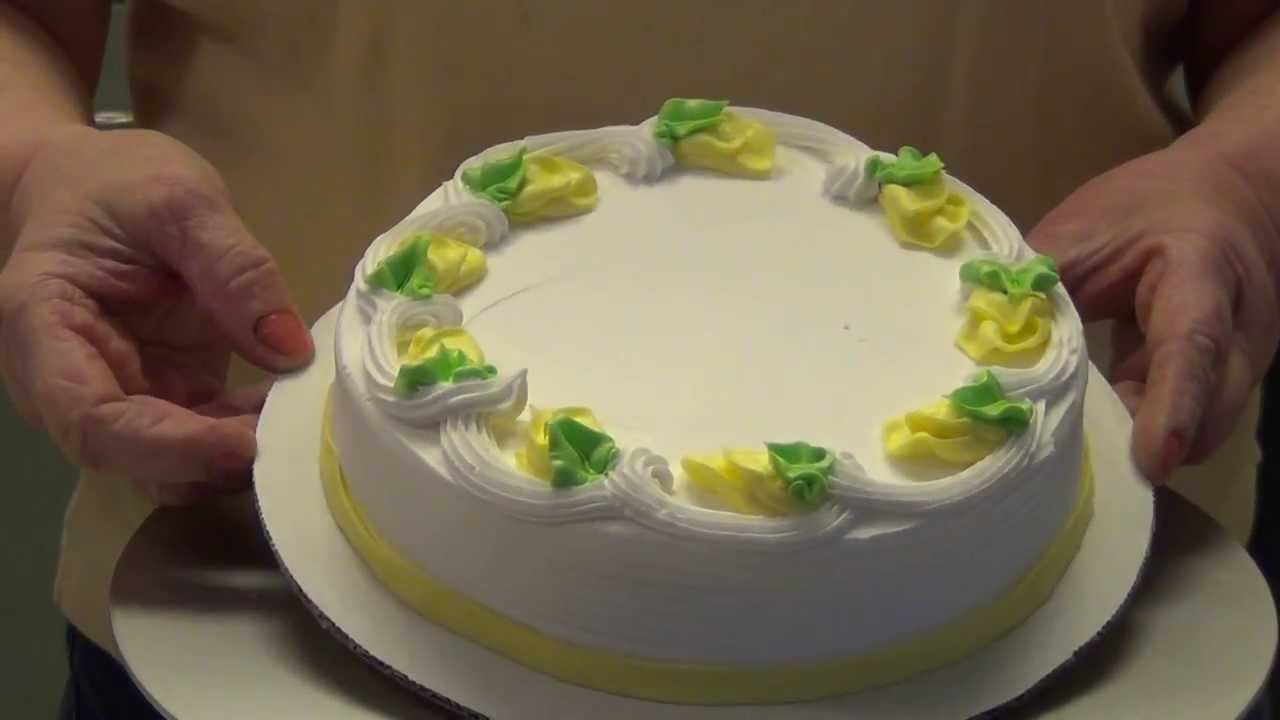 Ice A Cake Using An Easy Icer And Decorate With Rose Buds