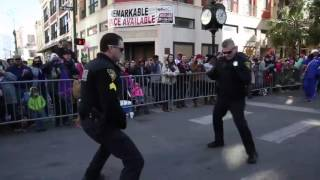 Cops hold dance off in the middle of a Mardi Gras parade