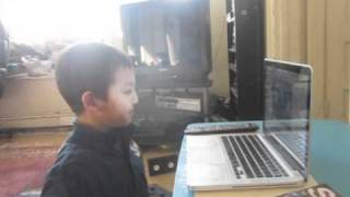autistic pddnos JACK age 7 makes PHOTOBOOTH VIDEO with his brother, with no help from grandma.