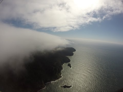 Clouds skimming in hang gliding at Cape Lookout, Oregon coast