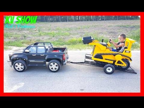 Playing With His Power Wheel Ride On Kid Trax Bulldozer, Chevy Silverado and Custom Tilt Trailer