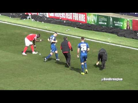 Charlton fans throw stress balls on the pitch