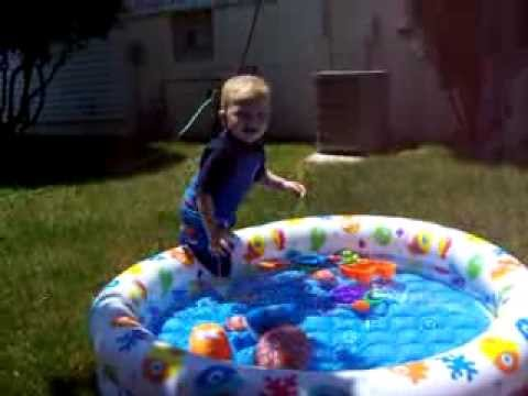 Avery, almost 2 yrs old... playing in his sprinkler and new little pool  June 8th, 2006