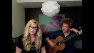 Grant Ferris performs with Jenna Christine in a YouTube video on Jenna's YouTube channel. Jenna has long, wavy blonde hair and is wearing dark rimmed glasses. Grant's hair is curly, and he is wearing a dark colored, long-sleeved shirt.  (thumbnail)