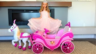 Polina goes to the ball in a princess dress and on beautiful carriage.