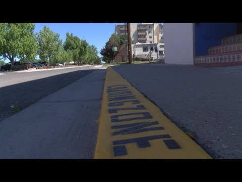 Albuquerque business illegally paints curb into a loading zone