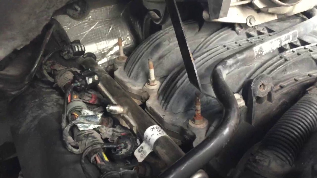 How to replace spark plugs and ignition coils on 2005 dodge durango ...