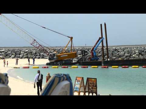 A crane, a Barge, the Beach. Only in Dubai