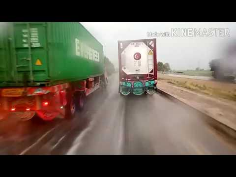 PAKISTAN! Road truckers at Lahore Karachi National highway to Karachi in rainy day