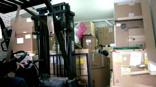 working in the warehouse with the forklift truck