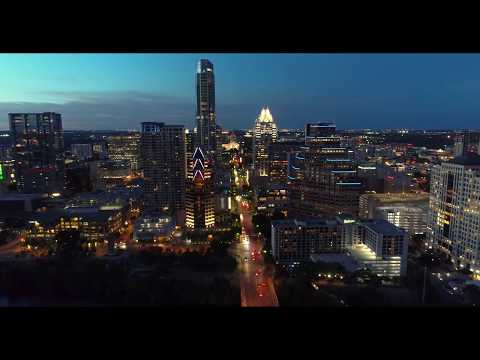 Aerial flyby of the Austin Skyline over the Congress Avenue Bridge