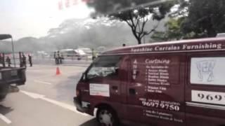 Lorry on fire along Lornie Road