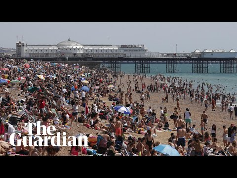 Sunbathers pack English beaches despite lockdown warning