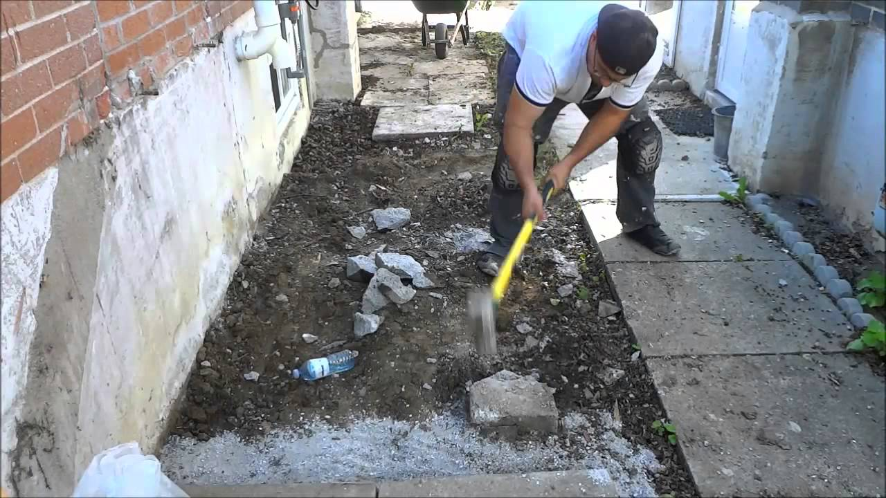 Smashing Cement Footings With A Sledgehammer You