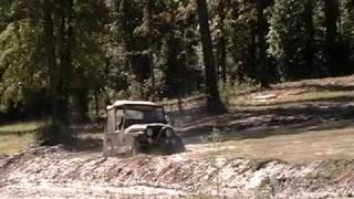 Monkey playing in the deep end of the mud hole showing off what that CJ7 can do.
