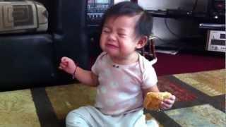 Baby eats sesame ball.