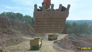 Doosan DX420LC loading dump trucks - excavator cab view