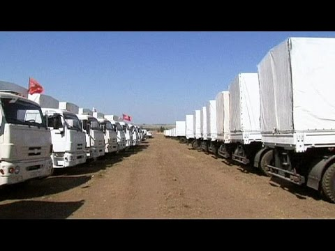 Ukraine's aid reaches east as Russian convoy remains stalled